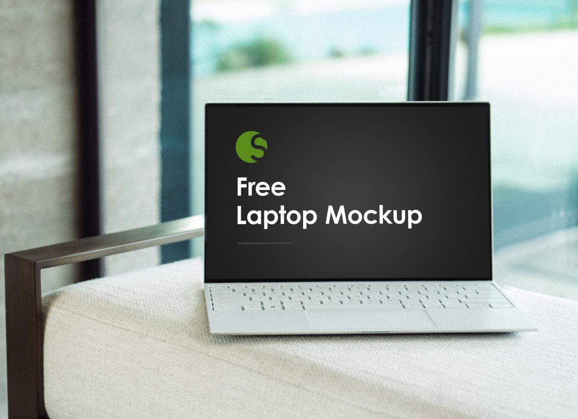 Free Laptop on Sofa Mockup PSD
